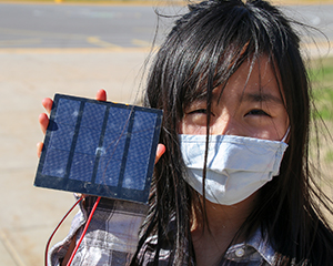 Girl holding a solar panel