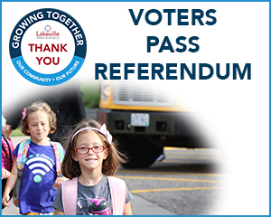 Two elementary students and text that reads Voters Pass Referendum