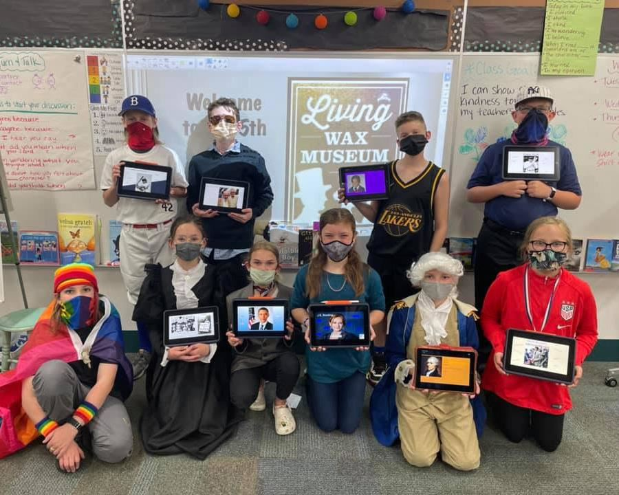 Group of fifth graders dressed as historical figures