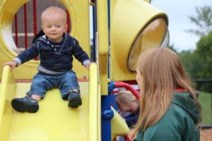 Toddler going down a slide